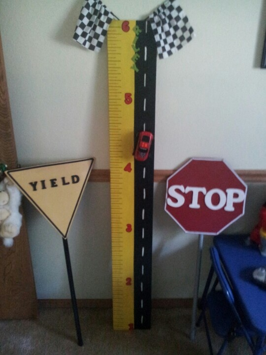 Growth chart and road signs for race car themed room