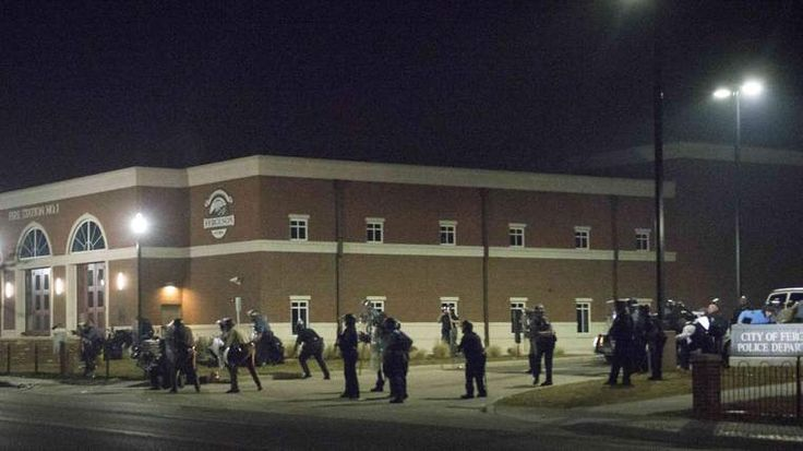 Two Police Officers Shot In Ferguson Protest  The protest erupts just hours after Ferguson's police chief quit following a damning justice report into his department. Posted by Jeremy Gleason Iscope Digital