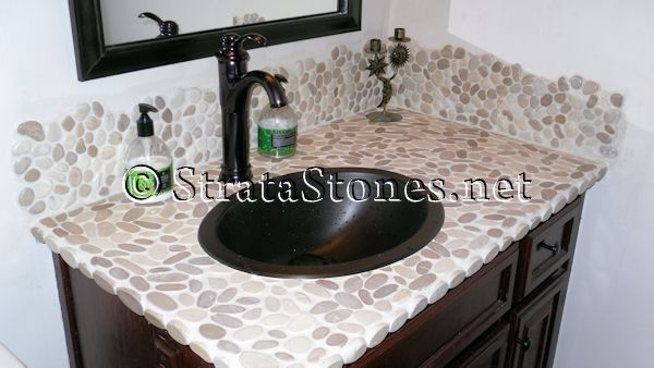 Sliced Tan Pebble Tile Bathroom Sink & Backsplash