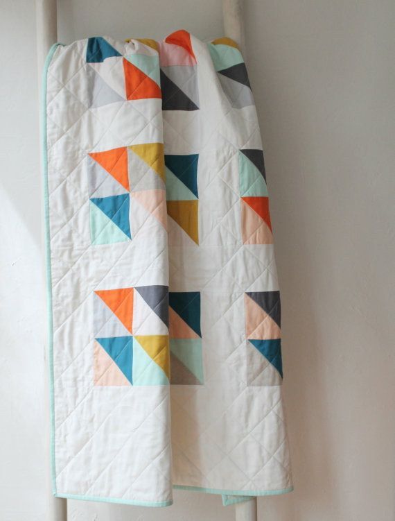 Handmade modern baby quilt in a sweet and cheerful geometric design made with custom colors of your choice. Choose from a range of…