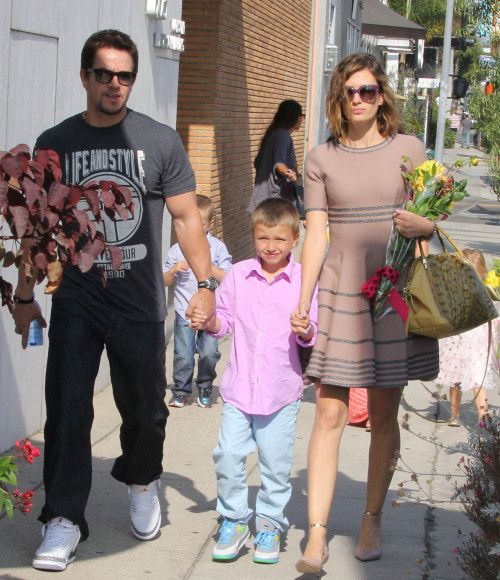 Mark Wahlberg.... Awe him  the kid both with some js on!!  Love him