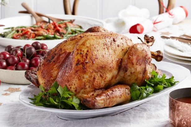 Christmas is complete with this juicy roast turkey served with anirresistiblecherry barbecue sauce.