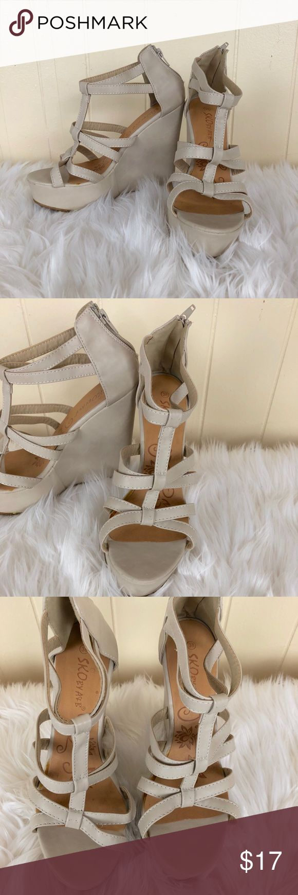 """Beige Strappy Nude Wedges Size 8 ✿Size: 8 ✿Color: Beige ✿Design: Strappy Wedge ✿Materials: Synthetic ✿Heel Height: Appx 5""""  Condition:Some glue is showing under the insole on shoes but is not visible when shoe is on. A couple of small scuffs on back top of wedges. Never been worn. Shoes Wedges"""