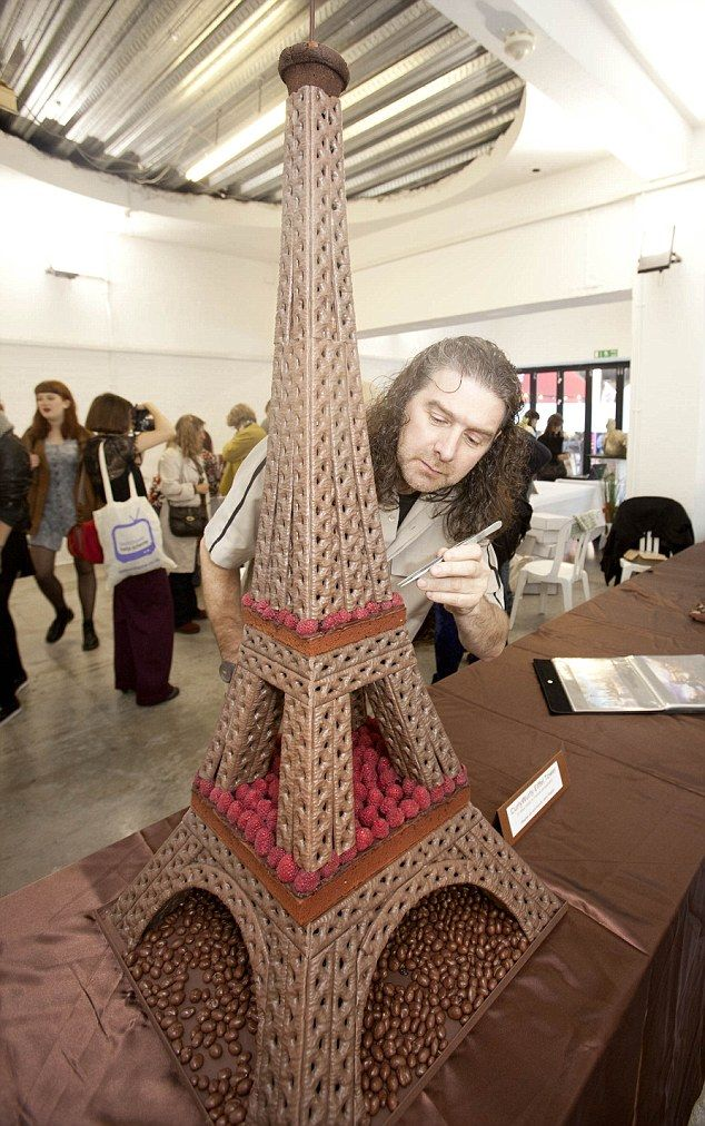 Food Modeller Paul Baker puts the finishing touches to his Curly Wurly Eiffel Tower