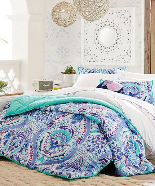 Kaleidoscope Teen Girl Comforter Looking for a fabulous teen girl comforter? This comforter brings uniquely bright design and superior comfort together for your best night's sleep. Made of cotton percale, it's a long-lasting and cozy addition to your bed.