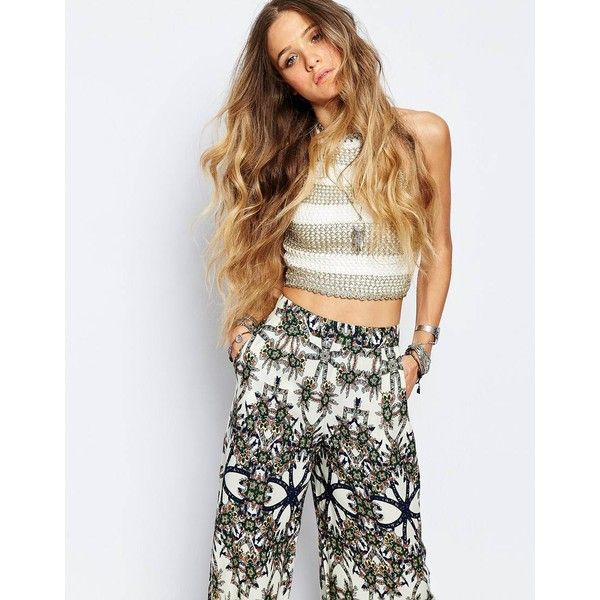 ebonie n ivory Knitted Festival Crop Top In Metallic Stripe ($49) ❤ liked on Polyvore featuring tops, goldivory, crop top, tie halter top, lace up top, striped crop top and striped halter top