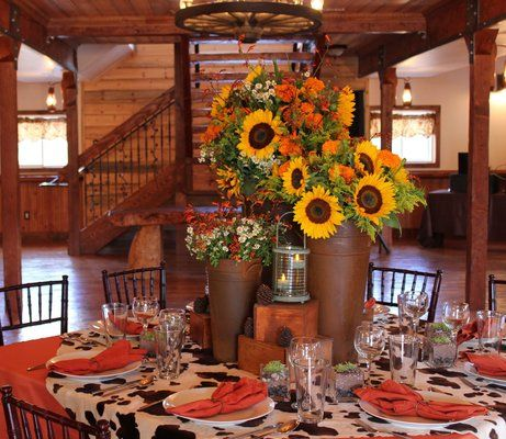 rustic western decor for grand opening party at deer creek valley ranch near denver