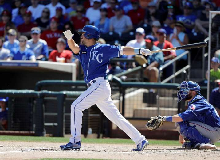 THAT'S GONE:    The Royals' Whit Merrifield singles during the spring training against the Rangers on March 29 in Surprise, Ariz. The score is 0-0.