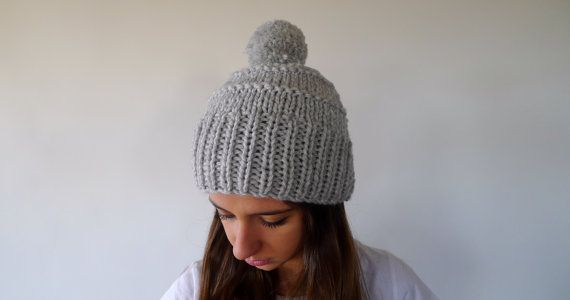 I'm a hand knit grey wool hat and I'm better than the one on the right: I'm as warm as its and I've got a big pompom on top! Take me home!  $25.59