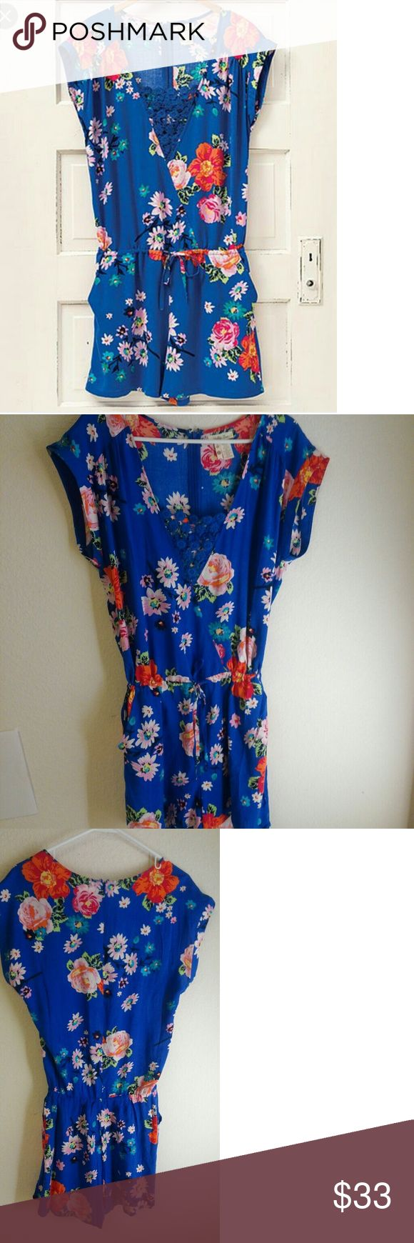 Matilda Jane Hello Lovely Out and about Romper Great shade of blue with bright flower print. Gorgeous details at the neck line. Zippered back. Excellent condition Matilda Jane Other