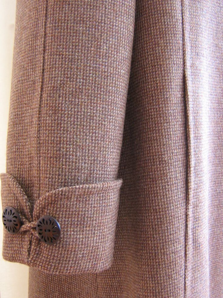 cuff detail on raglan sleeve coat