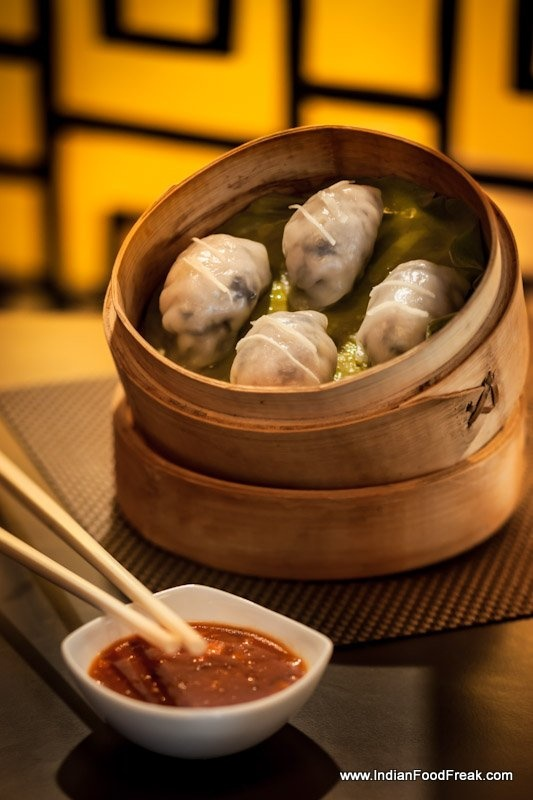 Chicken with Ginger in Glass Wrap ( When they say yum cha in China, it means 'drink tea'. But the idea is to go out for dim sum (light bites) like dumplings, rolls, cakes and steamed buns.)