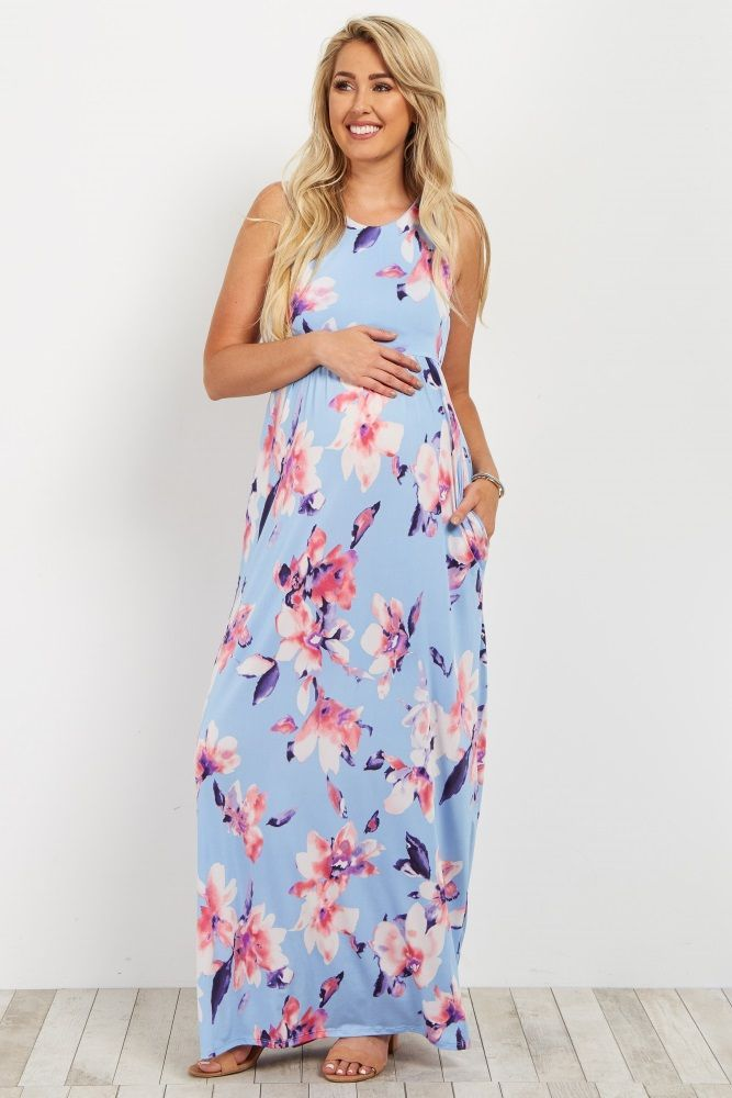4a840077a9321 Rose printed sleeveless maternity maxi dress. Racerback. Cinched under  bust. Pocketed. Rounded neckline. This style was created to be worn before,  during, ...