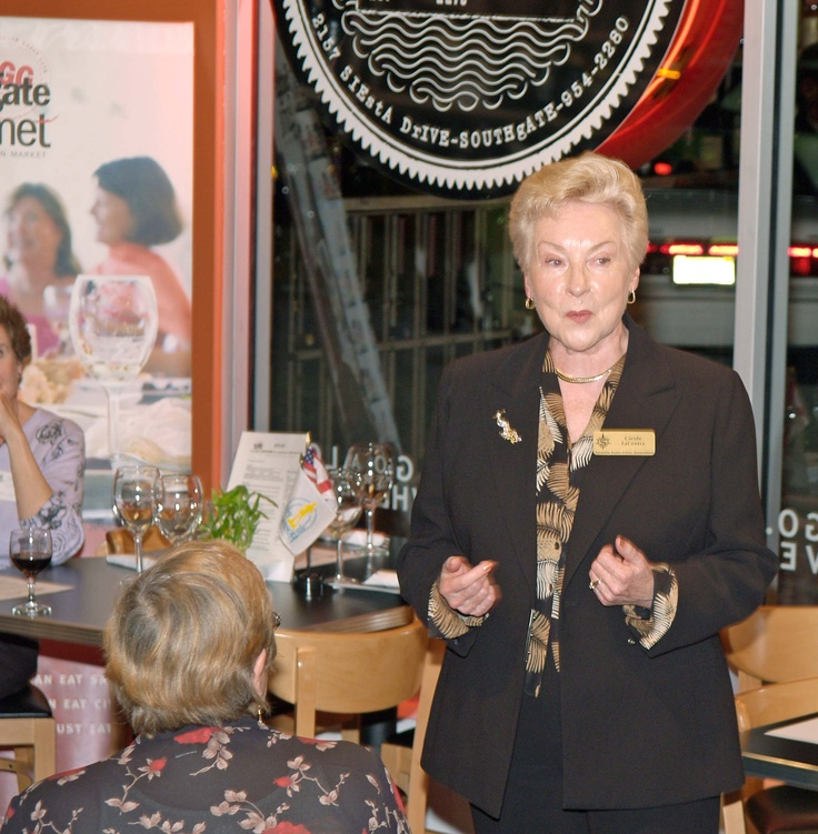 Carol LaCentra, Sarasota Sister Cities vice president for Arts & Culture, gives a report at the January 2006 Sarasota Sister Cities New Members orientation at Southgate Gourmet in Sarasota