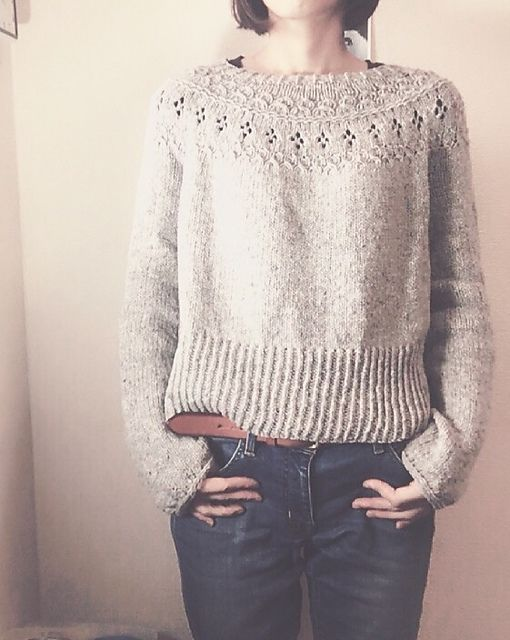Ranunculus is a round yoke pullover with lace and textured stitches.