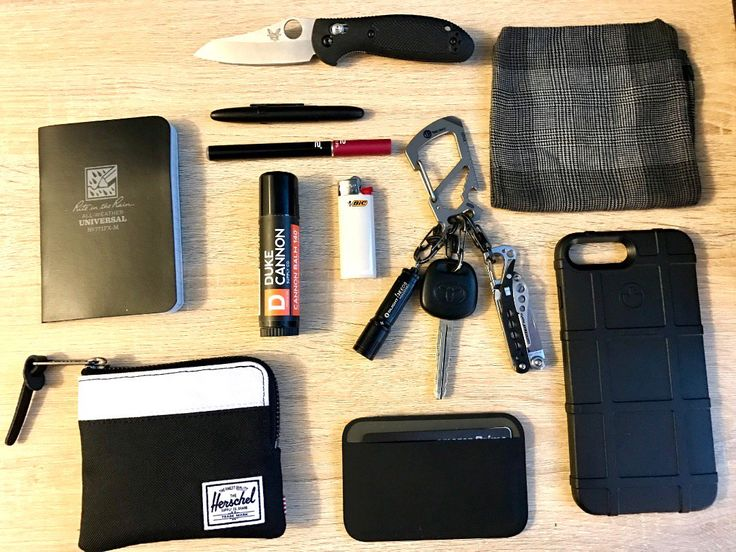 """Hard Days Work EDC  submitted by Andrew J Lopez  Herschel Supply Co. Johnny Wallet  Magpul Industries DAKA Polymer Wallet 3.75"""" x 2.67"""" Black  Magpul field case iPhone 7 plus  Rite In The Rain Notepad  Duke Cannon Balm 140 Tactical Lip Protectant Large .56 oz  Bic Mini Lighter  Tacray Carabiner  Olight I3E EOS  Leatherman Style CS  Dockers Handkerchief  v2 e-cig  Fisher Space Pen With Clip  Benchmade Mini Griptilian"""