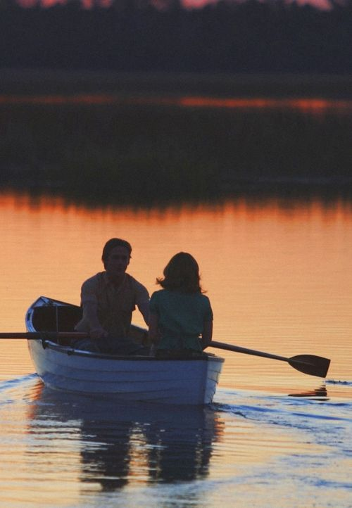 Canoeing with your love... like Ryan Gosling & Rachel McAdams in The Notebook - being alone with your love, surrounded by reflections of the sunset <3
