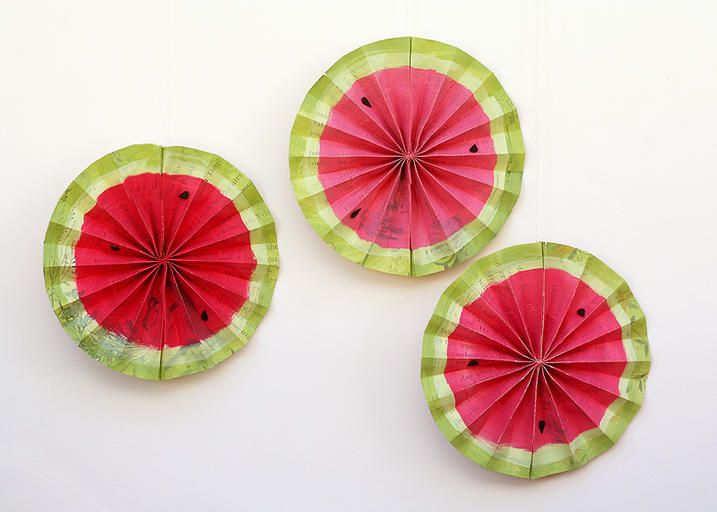 Decorate for your next summer barbecue with food-themed embellishments. DIY watermelon rosettes are easy to make and fun to display!