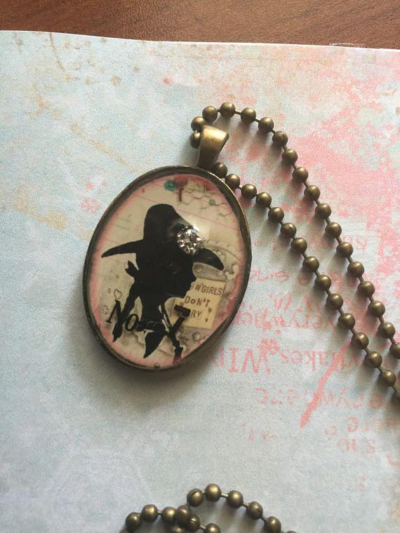 Rhinestone cowgirl image bronze metal oval bezel charm