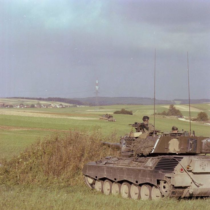 Exercise Certain Rampart 80. West Germany. 2 CF Leopard tanks in field deployment. DND photo