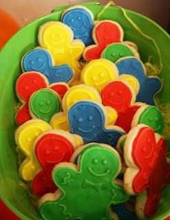 Use gingerbread cookie cutter. Use Candyland colors for icing