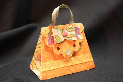 This adorable purse was made by Jan Jackson for our team swap.  You'll find this purse pattern (and many more) on our new Artiste Cricut Cartridge.  The paper is from the Flirty paper pack.