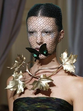 Ornate gold jewelry and a butterfly-topped headpiece at Giambattista Valli's Fall/Winter 2013 Haute Couture collection.