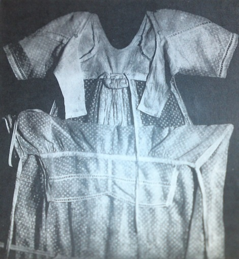 Bib front gown. Great picture that shows the construction of this gown.