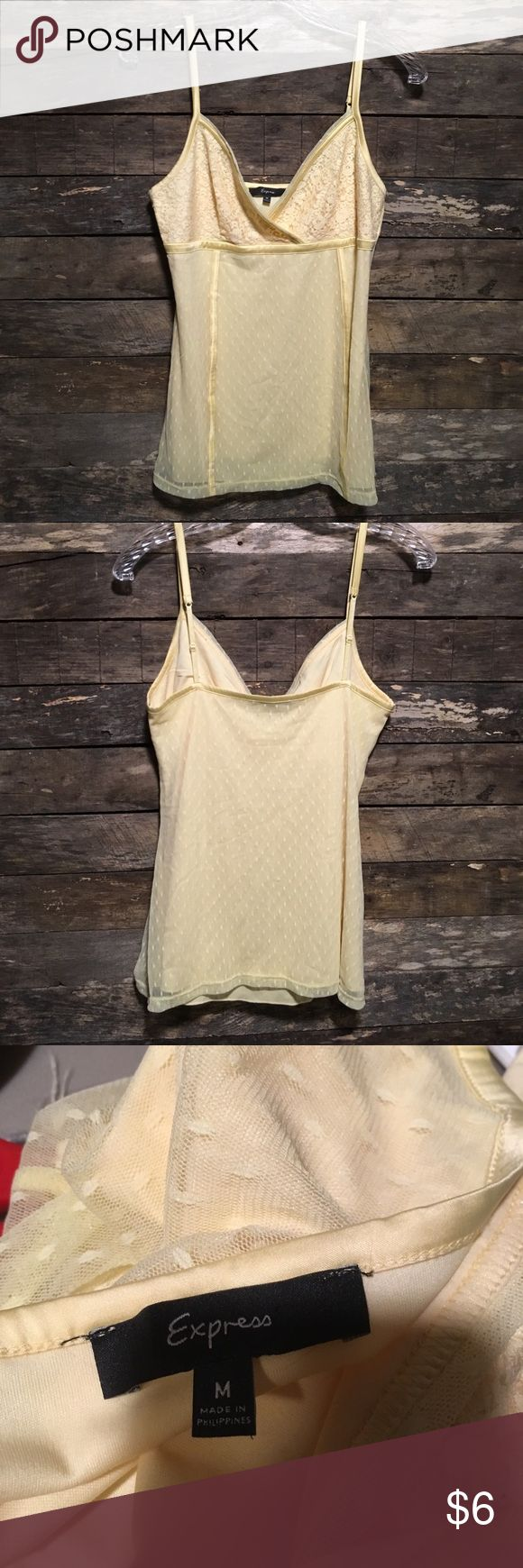 Express Yellow Cami Top All items are in gently worn condition with no stains, tears, or other noted flaws unless otherwise stated. Top is lined and can be worn with or without a jacket. From a smoke-free home. Please don't hesitate to make an offer. Bundle for private offers. Same or next day shipping unless work or travel prohibits. Express Tops