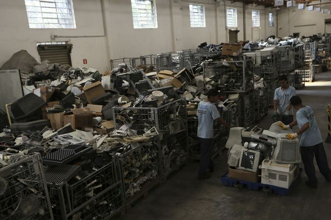 Employees pushed a cart loaded with discarded electronic products in São Paulo March 6. According to the United Nations Environment Program, Brazil generates the greatest amount of electronic waste per capita among emerging countries.