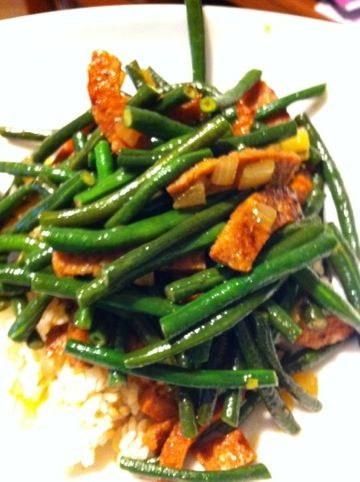 Portuguese Sausage and Green Beans Shana's recipe and she serves it over nice hot rice! 2-portugese sausages, cut into sticks 1 and 1/2 pounds green beans 2 medium onions, diced 3 Tbsp Soy Sauce Salt and Pepper to taste