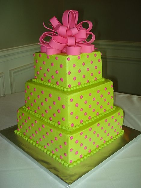 - This cake is iced smooth with buttercream.  Pink buttercream dots and gumpaste loop bow finish off the cake.