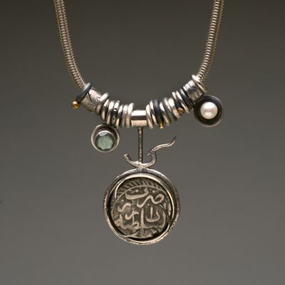 jewelry image of Ancient coin from India. Sterling silver, 18k gold, pearl, labradorite. Hangs on snack chain including a handcrafted clasp.