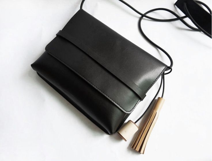 Simple Black Leather Crossbody bag with wood and leather tassel wholesale whole sale by CloudAndRock on Etsy https://www.etsy.com/listing/231490117/simple-black-leather-crossbody-bag-with