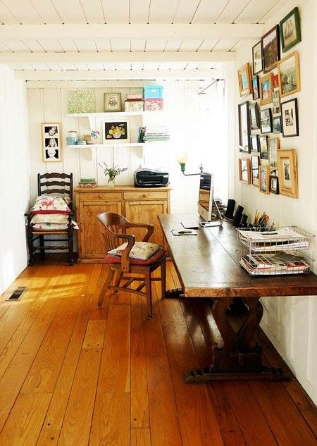 A studio with a writing area: hardwood or non-carpeted floor, big long desk, sunny window. Needs more storage and more width. I have that library chair already