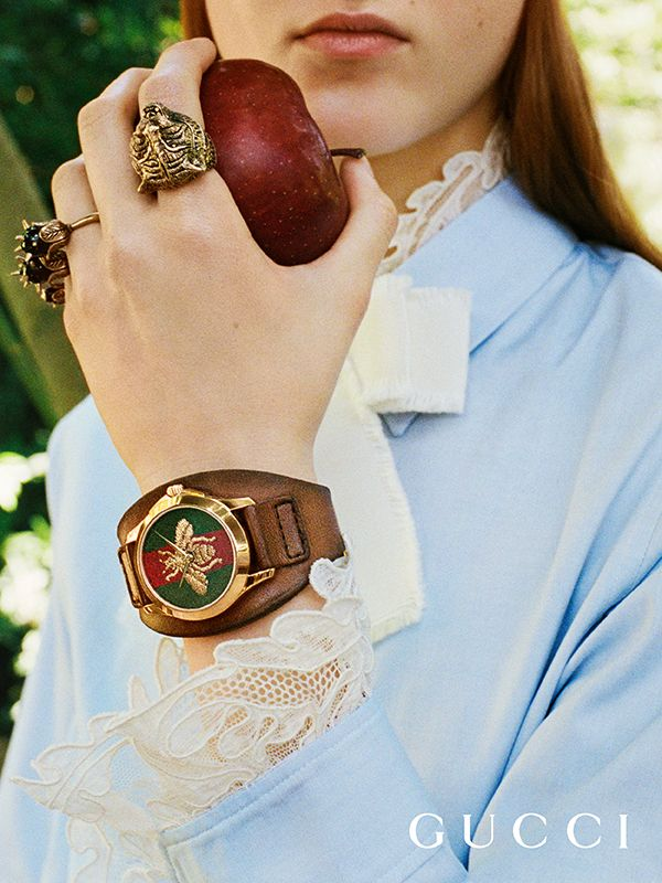 Presenting gifts from the Gucci Garden. The G-Timeless leather watch with an embroidered gold bee on the dial and rings featuring a feline head and studs by Alessandro Michele.