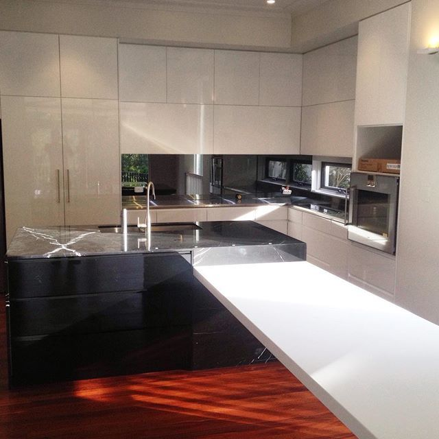 What a statement this marble makes! A gorgeous black marble island in an all white kitchen, this really is stunning and the photo doesn't quite do it justice! Love creating beautiful kitchens like these for our clients!#totalkitchens #kitchendesign #designerkitchen #kitchen #marble #kitchencabinets #customkitchen #kitchenmakeover #kitchenrenovation #kitchenreno #islandbench #marble #sydneykitchens
