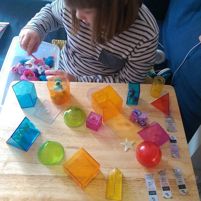 Day 22 #100daysofhomeed  The way play and learning evolves when it's left to happen naturally is an amazing thing. Last night Lottie did a maths workbook and did a page on 3D shape, she then asked me where our plastic 3D shapes were, so I found them for her. She played with them for ages today. She tried to build a tower using all of them and then got her mini crystal My Little Ponies where some of them were trapped in 'shape prisons'. Through her play we ended up talking about shape names…