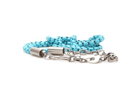 Extra thin coloured metallic chain belt with a hanging metallic fastener.
