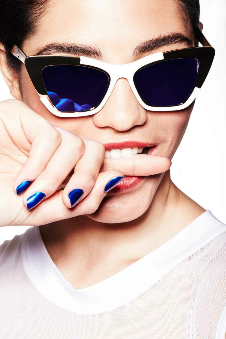 "Punch-Drunk We're loving these metallic blue nails, so to match them without taking away from their impact, we went with a Kool-Aid-stained pout. Hubbard used the same stain on both lips and cheeks, applied with his fingers. ""To keep it casual, don't use a lip liner. The edge shouldn't be defined at all, like you just ate sorbet or drank punch."" Karen Walker Siouxsie Sunglasses, $280, available at Les Nouvelles; Norma Kamali Long Sleeve Midriff Top, $145, available at Norma Kamali; Face…"