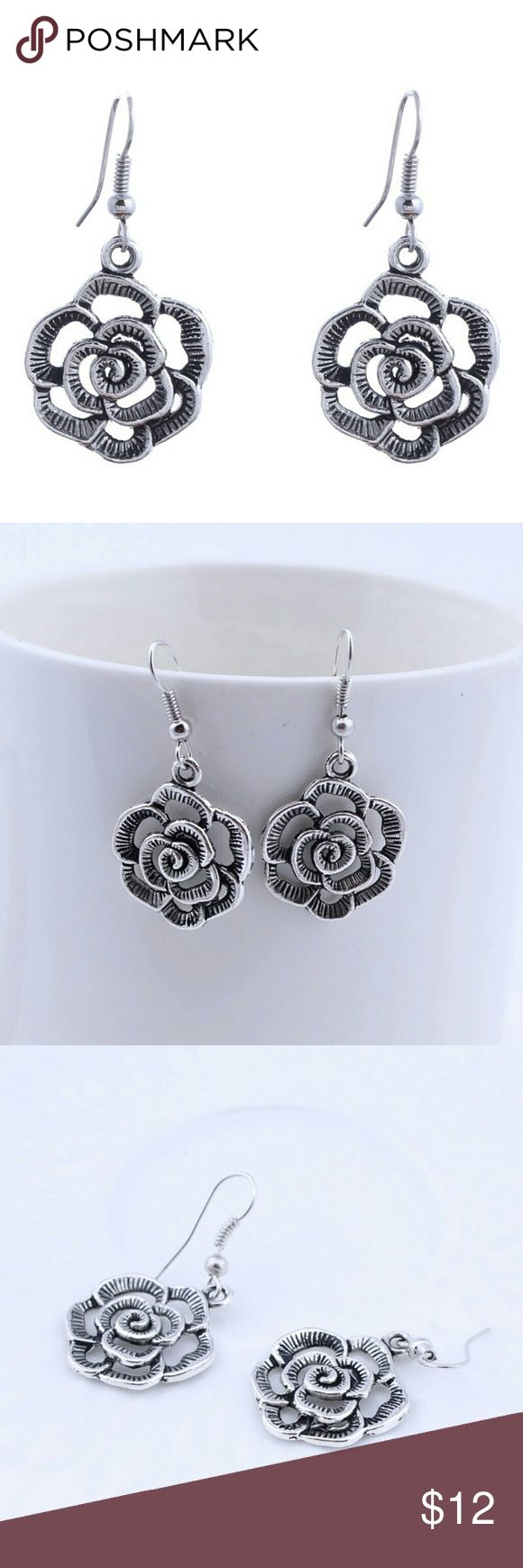 Vintage Rose earrings Brand new with tags. Fall inlove with these bohemian style rose earrings. Simple light and super cute! High quality costume jewelry. Antique silver ated. Gift box included with this purchase. Offers Welcome!! Also buy one get one half off and buy 2 get one free on bundles!! Costume Jewelry Jewelry Earrings