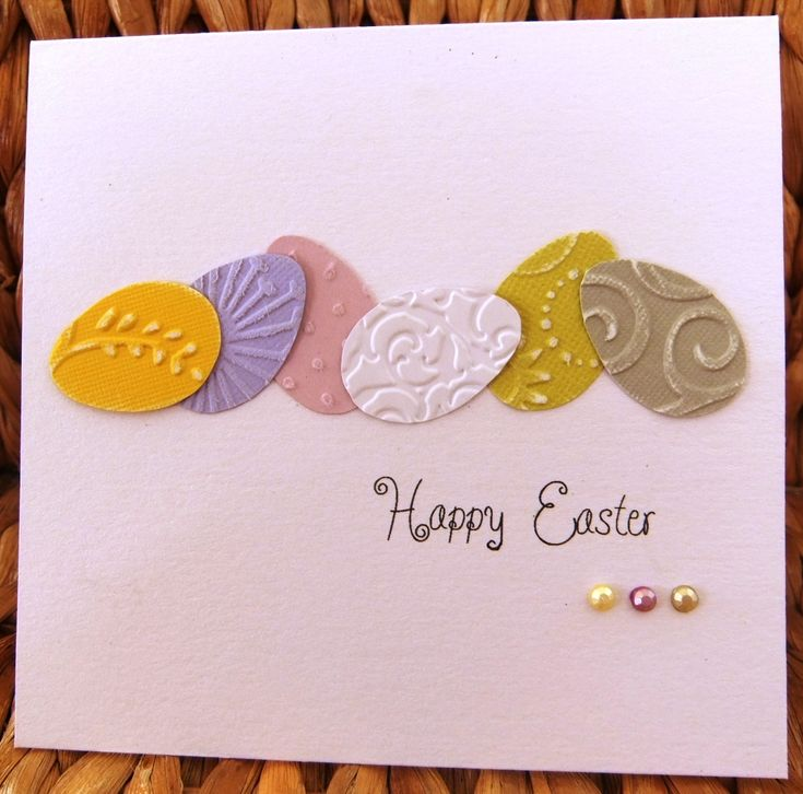 handnmade Easter card ... clean and simple ... frow of die cut Easter eggs with embossing folder textures ... great card!!