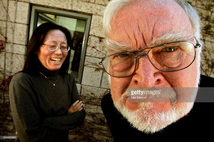 Professor Mihaly Csikszentmihalyi jokingly makes a scowling face wiith Professor Jeanne Nakamura, the two are co–directors of the new program in positive psychology at Claremont Graduate University. (Professor Csikszentmihalyi said that in a previous photo shoot, he had to hold a big grin for 30 minutes straight and was still recovering). They were photographed in the courtyard of the Drucker–Ito School of Management in Claremont on March 14, 2007.