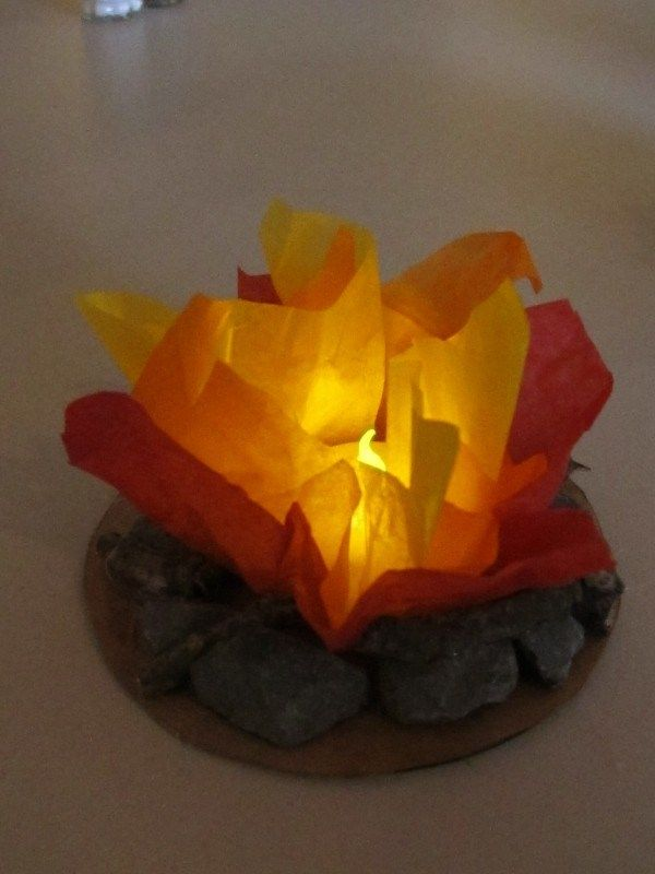 """Indoor campfire with flame less candle.  Cute Blue and Gold center pieces! """"We made a larger on for our VBS quiet time around the camp fire, It was hit with our kids  and adults! """""""