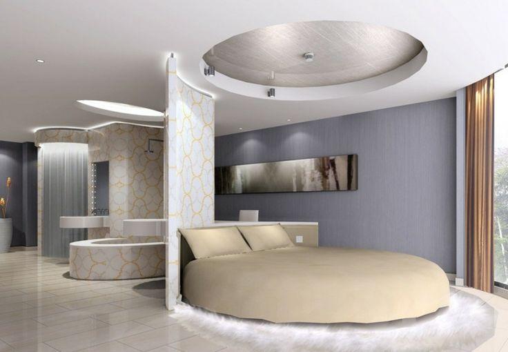 lit rond design et plafond décoratif assorti avec spots