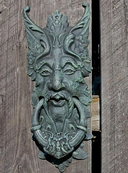 Large door knocker or gate keeper retains a timeless appeal, a symbol of rebirth and spring. Cast Iron Green Man features fine detail with verdegris finish