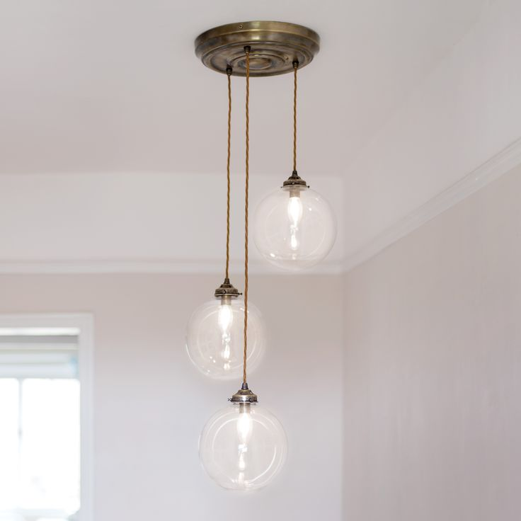 A stunning, #handcrafted multi- pendant #light with #glass shades. The smooth #sphere of our beautiful Holborn Pendant #Light is in #triplicate on this clever light which hangs from a single #ceiling fixing.