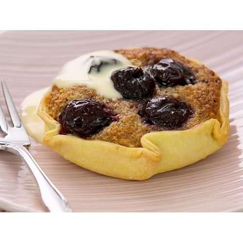 Free-form cherry hazelnut tarts recipe - By Woman's Day,  The older kids will enjoy helping to prepare this simple nut and cherry tart ... hopefully as much as they will enjoy eating it!