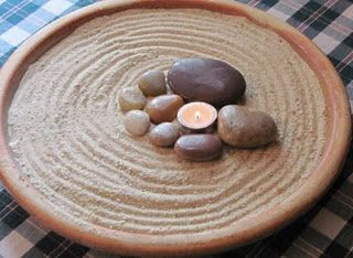 Another example of a diy meditation garden. For this, a planter saucer, or any other similar dish will do. Add pretty rocks and a candle to finish it.