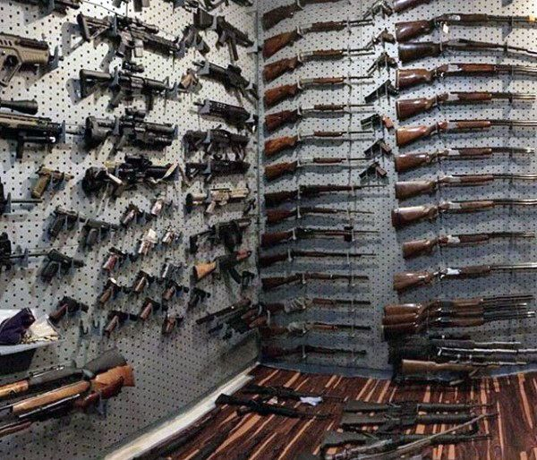 Hardwood Floors In Gun Room With Grey Wall Racks Any